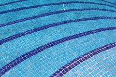 Curving swimming pool steps. Curving tiled swimming pool steps Stock Images