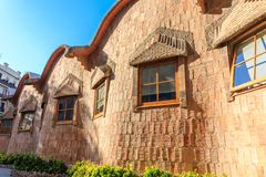 Curving Walls on Stone Cottage. Windows in Curving Walls on Stone Cottage Royalty Free Stock Images