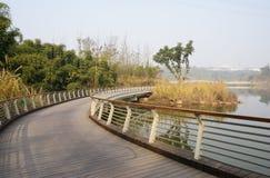 Curving waterside footbridge in sunny winter afternoon. Chengdu,China stock photo