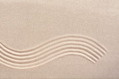 Curving wave pattern in a Japanese zen garden Stock Photo