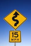 curvy предупреждение дорожного знака стоковое фото rf