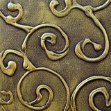 Curvy abstract metallic background. Abstract painted christmas background pattern in old antique textured bronze and gold ornamental design Royalty Free Stock Photo