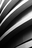 Curvy architecture piece. Black and white photo of a fragment of the building pane with curvy lines formed by the ledges Royalty Free Stock Image