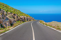 Curvy asphalt road leading to amazing sea bay stock photos