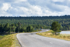 Curvy asphalt road before the storm. Royalty Free Stock Image