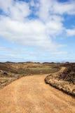 Curvy bana på ön av Los Lobos, kanariefågelöar Arkivfoto