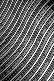 Curvy Building. Windows on a building creating a curvy pattern stock photo