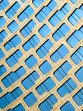 Curvy Building. Windows on a building creating a curvy pattern Royalty Free Stock Images