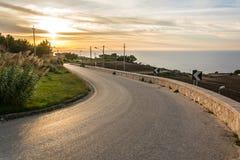 Curvy coastal road at sunset. In Mediterranean landscape royalty free stock photo