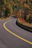 Curvy country road. In autumn Stock Photography