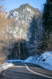 Curvy country road in the mountains, winter landscape Stock Photo