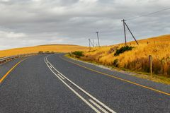 Curvy countryside road in South Africa in spring season royalty free stock photo
