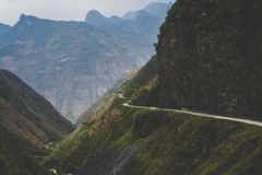 The curvy and dangerous road in the mountains in Northern Vietnam. Dangerous road in the mountains in Northern Vietnam, Ha Giang province Stock Photography