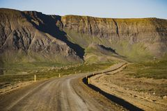 Curvy gravel road in Snaefellsnes Peninsula Vesturland, Iceland. At summer season cloudy day royalty free stock photography