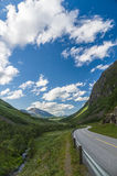 Curvy and lonely road between norwegian hills Royalty Free Stock Image