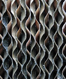 Curvy Metal Vent. A closeup of an air conditioner vent that provides interesting shapes and texture Royalty Free Stock Photos