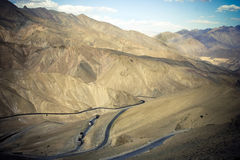 Curvy mountain road in Himalaya. Stock Photos