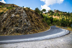 Curvy mountain road in Mediterranean mountains,. Getting off royalty free stock photos