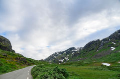 Curvy mountain road between scenic rocks. Norwegian landscape Royalty Free Stock Photos