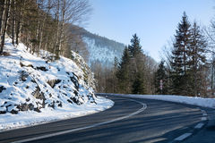 Curvy mountain road, winter landscape Stock Photo