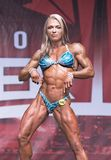Curvy, Muscled Female Physique Athlete Poses at 2018 Toronto Pro Supershow Royalty Free Stock Images