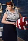 Curvy pin-up girl. On the boat at summer royalty free stock photos