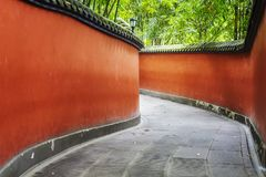 Curvy red walls passage surrounded by bamboo forest. Curvy red walls passage surrounded by bamboo forest, Wuhou Temple in Chengdu, China Royalty Free Stock Images