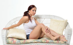 Curvy redheaded woman in tank top and shorts Royalty Free Stock Photo