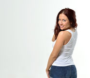 Curvy redheaded woman in tank top and shorts Stock Photography