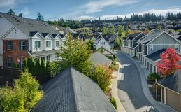 Curvy Residential Road in Issaquah, Wa. Houses line a Curvy Road that cuts through Residential Neighboorhoods in the Issaquah Highlands on an Autumn Morning Royalty Free Stock Image