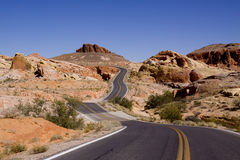 Curvy road. Curvy asphalt road through red rocks stock image