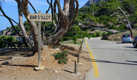 Curvy road and bar sign by S'Illot Royalty Free Stock Images
