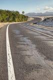 Curvy road in desert Stock Images