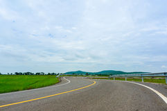 Curvy Road Of Fresh Green in country town Royalty Free Stock Images