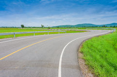 Curvy Road Of Fresh Green in country town Stock Photo