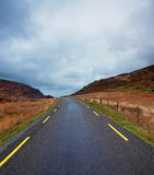 Curvy road in the Gap of Dunloe, County Kerry, Ireland Royalty Free Stock Photography