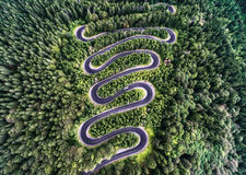 Curvy road from the high mountain pass in Transfagarasan, Romania. Royalty Free Stock Photos