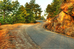 Curvy road by the hill Stock Photos