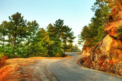 Curvy road by the hill Royalty Free Stock Images