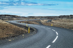 Curvy road in Iceland on a sunny day Royalty Free Stock Photos