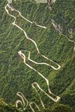 Curvy road leading to the cave at Tianmen Mountain China royalty free stock photography