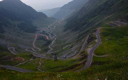 Curvy road in mountains, traffic lights stock photo