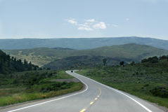 Curvy Road In Nature. A streched winding curved road over McLure Pass Colorado Stock Photos