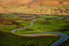 Curving Road, Peak District,United Kingdom. A curvy road in Peak District National Park, Derbyshire, England, near Mam Tor, a part of the Great Ridge, a popular royalty free stock photography