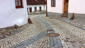 Curvy road in a pitoresque city. Curvy road in a pitoresque medieval with ancient coloured pavement Stock Images