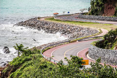 Curvy Road by the Sea. Curves at Chalerm Burapha Chonlathit road Royalty Free Stock Photo