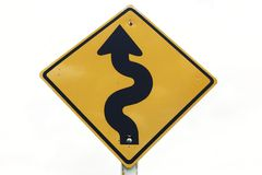 Curvy road sign. Isolated on white background stock photos