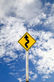 Curvy Road Sign on blue sky background with clipping path. Stock Photo