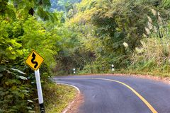 Curvy road sign on mountain.  stock photo
