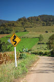 Curvy road sign in thailand Stock Photos